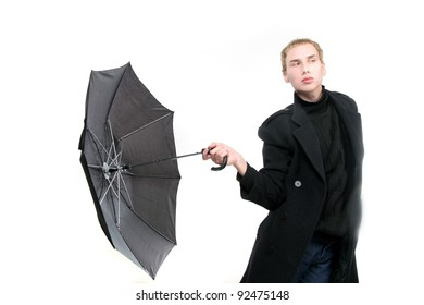 fashionable young man with umbrella over white