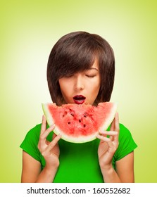 Fashionable young woman holding a slice of watermelon near the mouth