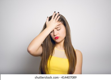Fashionable young woman made a mistake, in yellow close-up isolated