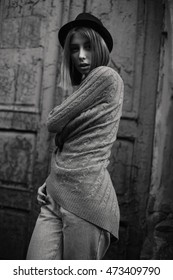 Fashionable young woman in the old city. Black and white