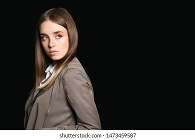 Fashionable young woman on dark background