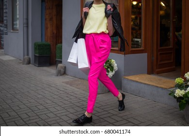 Fashionable young woman on a shopping spree