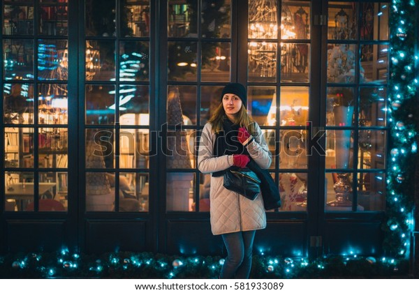 Fashionable young woman posing outside in a city street. Winter Fashion
