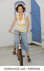 Fashionable young woman riding vintage bicycle.
