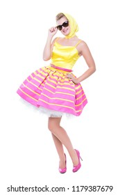 Fashionable young woman wearing pink and yellow dress. Isolated on white