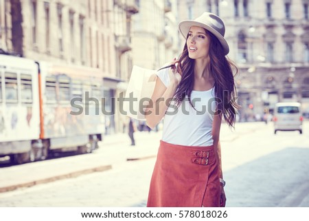 Fashionably dressed woman on the streets of a small Italian town, shopping concept