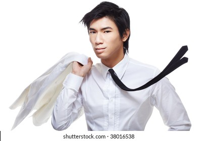 Fashionably stylish, good looking metrosexual Chinese model dressed in all white. Shot with a sense of motion with him flipping jacket over shoulder and tie flying.