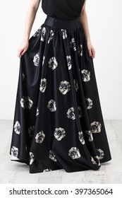 7fb0a51656 Fashionista in black shirt and long skirt with floral print