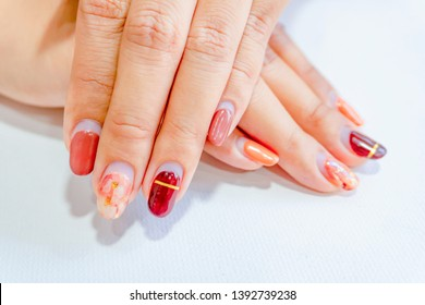 fashionista woman fingernail painting beautiful brown color marble gel nail art decorated with crushed shell, image show after doing manicure more than one month