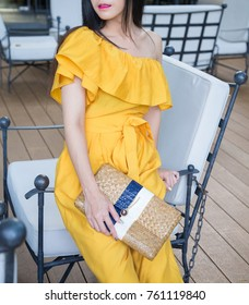 Fashionistas Asian girl wearing yellow dress and handbag , Summer time , vacation style