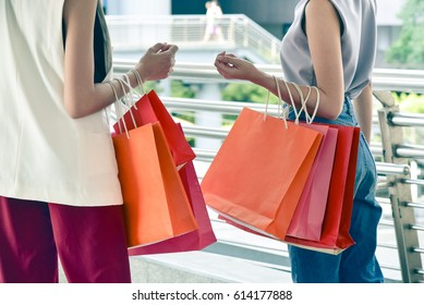 fasion concept : women  carry the paper bags for shopping in the new department store
