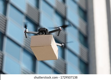 Fast air shipping, contactless and safe delivery. Drone flying through the air with a delivery box package