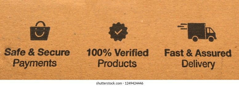 Fast and assured delivery, safe and secure payments and 100 percent verified products concept printed on cardboard.