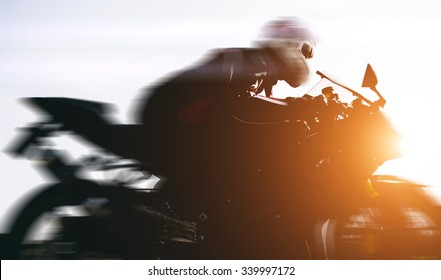 Fast biker driving on the street. concept about transportation and motorbikes