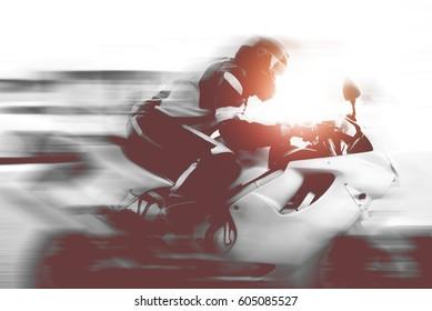 Fast biker driving on the street.