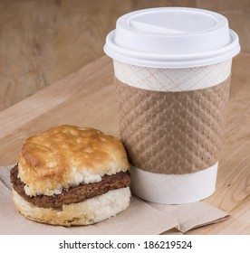 A fast breakfast of biscuits  sausage and coffee