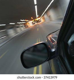 Fast car moving in motion through a tunnel