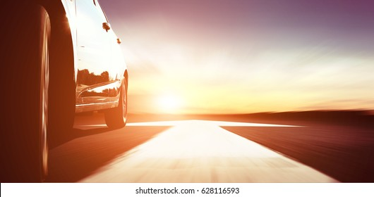 fast car on highway with arrow at the sunset