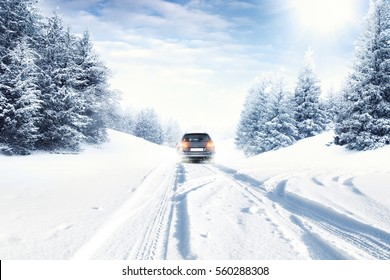 fast car on winter road and snow splash
