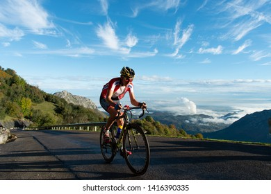 Fast cyclist with blue sky background in Angliru, Asturias 11 of October 2015