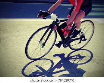 fast cyclist over her bike during the curve on the road