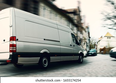 Fast delivery van in a narrow street. A challenge for logistics and transportation.