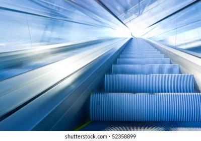 Fast escalator move in office centre