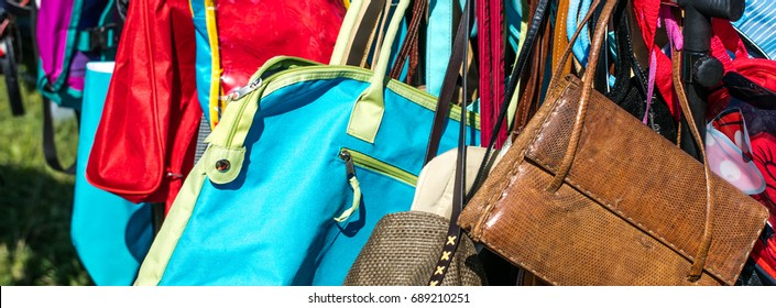 fast fashion women bags and purses on display at flea market or thrift store to resale, reuse, recycle, donate or exchange outdoor
