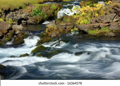 Fast flowing river, Iceland.