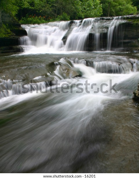 Fast flowing river waterfalls were one of the many in Robert Treman State Park, Ithaca, NY.