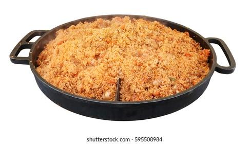 Fast food of the big city - metal  big frying pan with hot Asian pilaf.