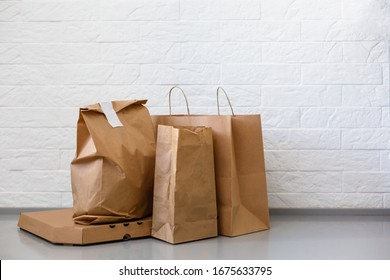 Fast food eco packaging with big lunch set of tasty hamburger, french fries, paper brown paper bag and box on the table isolated on white background