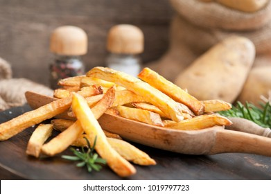 Fast food, french fries potatoes with skin served with salt and herbs, French fries