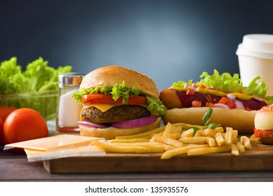 fast food group  photo of  hot dog,  burger, french fries, tomato drinks and many more