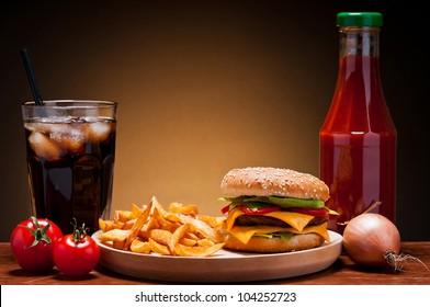 fast food hamburger menu with burger, french fries, cola and ketchup