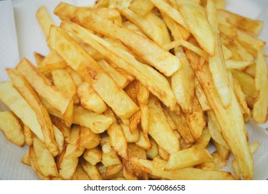 Fast Food, Homemade French Fries or Finger Chips Often Served with A Side of Ketchup, Mayonnaise, Vinegar, Barbecue Sauce or Other Sauce. Selective Focus and Close Up.