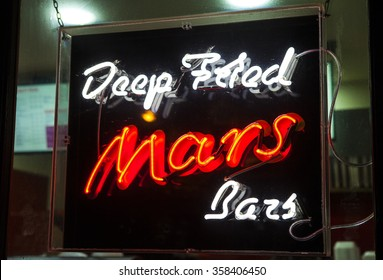A fast food restaurant in Edinburgh advertising Deep Fried Mars Bars.  Deep Fried chocolate is a novelty and delicacy originating from Scotland.