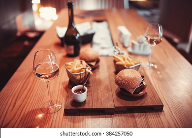 fast food set big hamburger and french fries with wine. shallow DOF