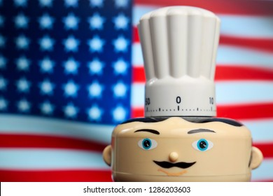 Fast food symbol. Kitchen clock. American chef with big toque on waving American flag in background. Food delivery. Restaurant serving hamburgers and other American specialties. Menu card idea - Image