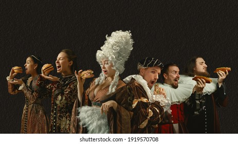 Fast food tastes good. Medieval people as a royalty persons in vintage clothing on dark background. Concept of comparison of eras, modernity and renaissance, baroque style. Creative collage.