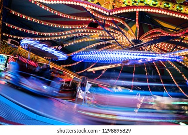 fast  funfair ride carousel at the christmas market, long exposure with blurred motion, abstract background, copy space