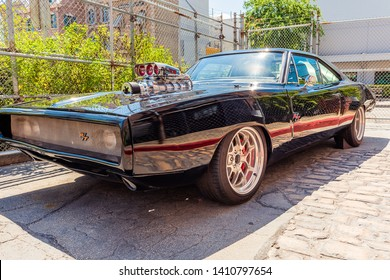 Fast and Furious dodge charger black shiny sports car with lots of chrome was from a movie and is roped off outside the movies ride at Universal Studios Orlando Florida on March 24 2019