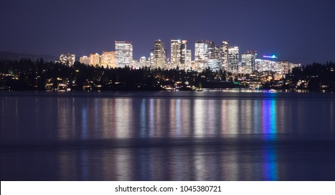 Fast growing Bellevue Washington city light reflecting in the water view from across the lake
