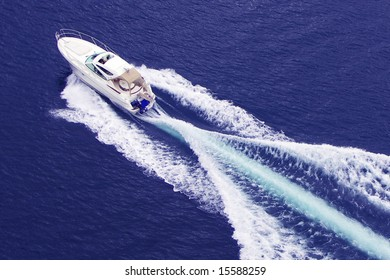 fast motor boat with splash and wake