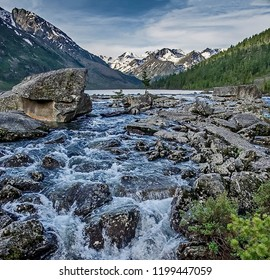 Fast mountain river. Waterfall. Headwaters mountain river. The Tumnin River is the largest river on the eastern slope of the Sikhote-Alin Range.