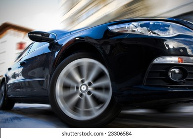 Fast moving car with motion blur