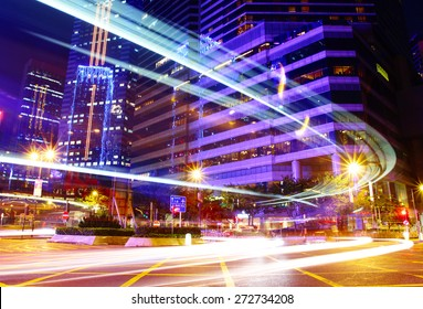 Fast moving car trail in city at night