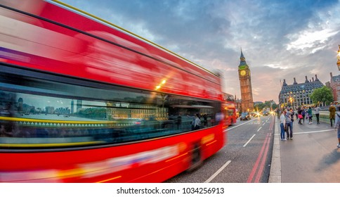Fast moving Double Decker bus on Westminster Bridge at sunset, London.