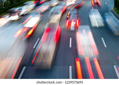Fast moving traffic in city evening.