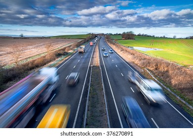 Fast moving Vehicles on Busy Motorway at the Morning